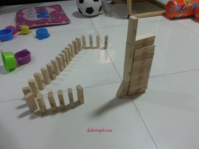 Roll a ball from the top of the tall structure and see what happens
