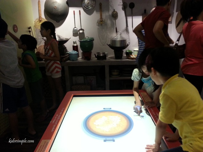Interactive digital display of cooking different ethnic dishes