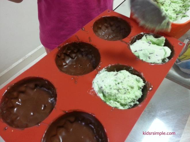 Scoop ice-cream into moulds