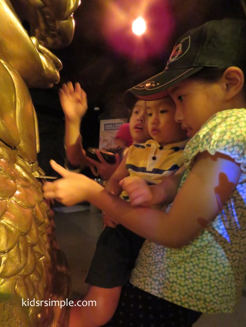 The kids were inserting a card in exchange for a Gold coin souvenir (SX60HS)